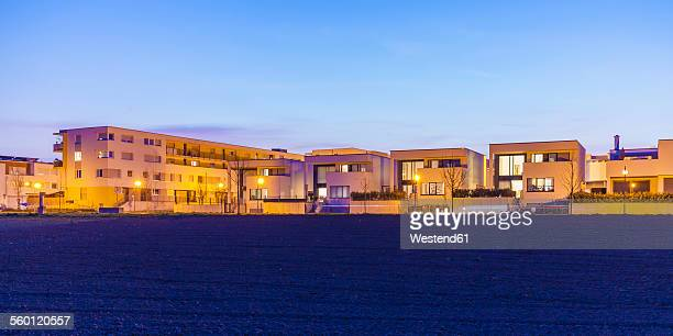 Germany, Ludwigsburg, development area, one-family houses and multi-family houses at dusk