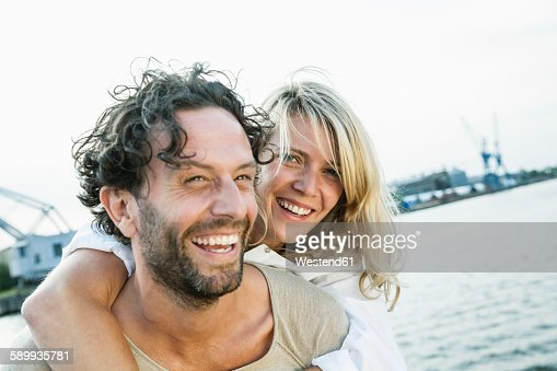 Germany, Luebeck, happy couple at the waterside