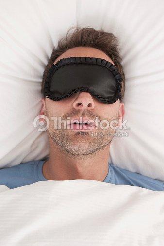 germany man wearing sleep mask sleeping stock photo. Black Bedroom Furniture Sets. Home Design Ideas