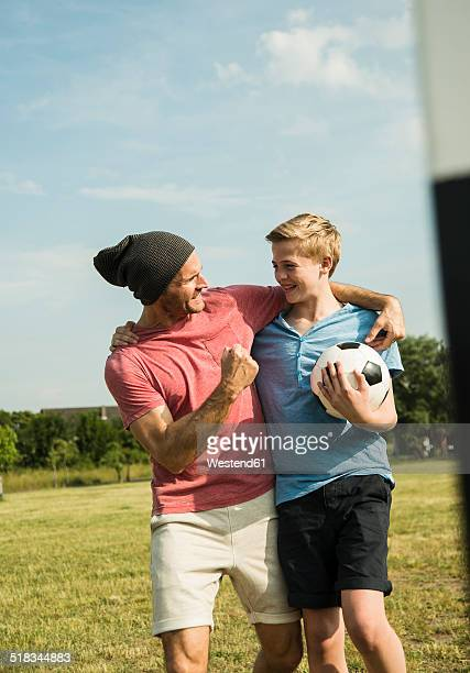 Germany, Mannheim, Father and son playing soccer