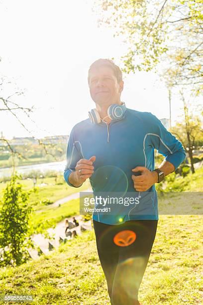 Germany, Mannheim, Mature man jogging in park