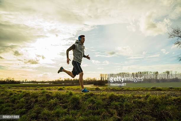 Germany, Mannheim, young man jogging