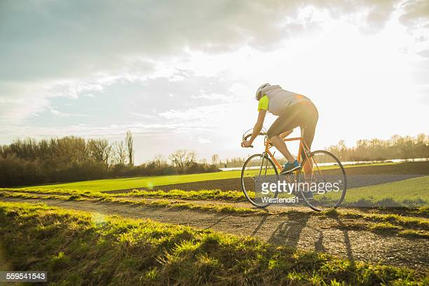 Germany, Mannheim, young man riding bicycle