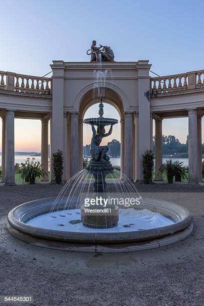 Germany, Mecklenburg-Vorpommern, Schwerin, fountain in Burggarten in the morning