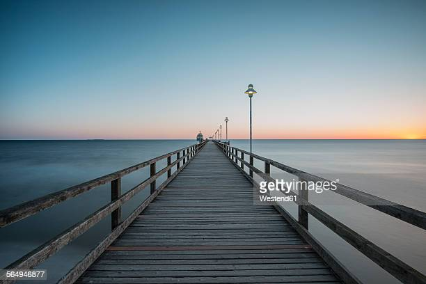Germany, Mecklenburg-Western Pomerania, Baltic Sea, pier of Zinnowitz at dawn
