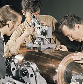 Germany Men are checking a press cylinder for rotary printing no date caption approximately 1980s