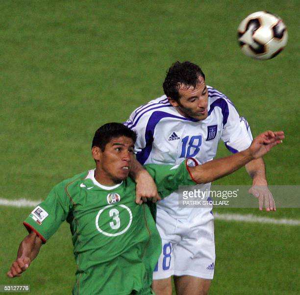 Mexican defender Carlos Salcido vies withGreek defender Ioannis Goumas during the Confederations cup football match Greece vs Mexico 22 June 2005 at...