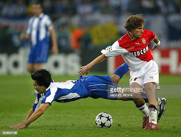 Monaco's Italian midfielder Lucas Bernardi tackles Porto's Brazilian midfielder Deco during the Champions League final football match 26 May 2004 at...