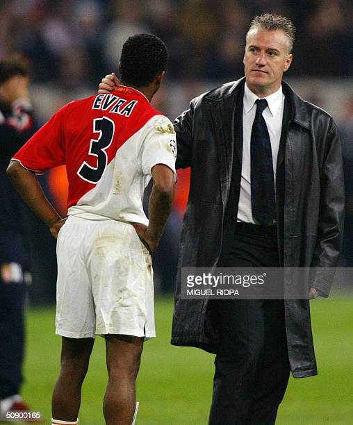 Monaco's manager Didier Deschamps consoles Patrice Evra after Monaco were beaten 30 by Porto in the final of the Champions league football match 26...