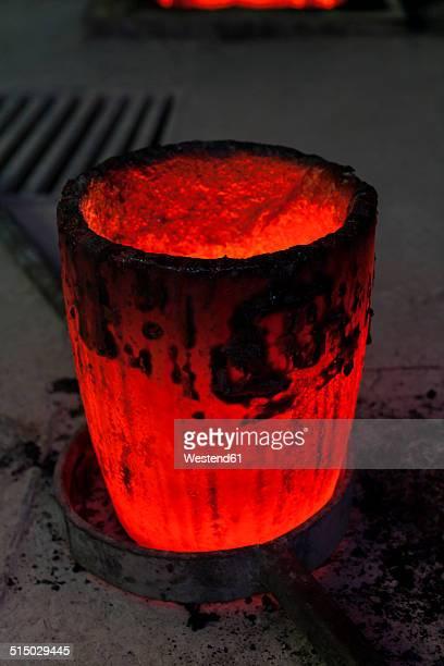 Germany, Munich, Art foundry, Molten metal in ladle