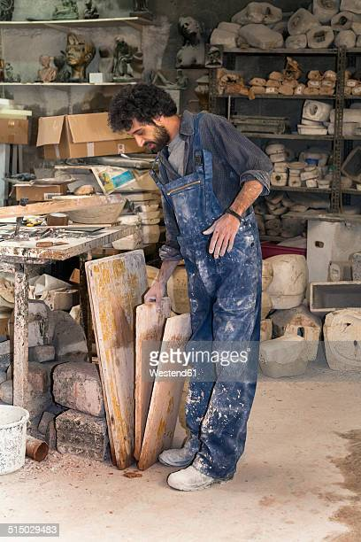 Germany, Munich, Art foundry worker in workshop