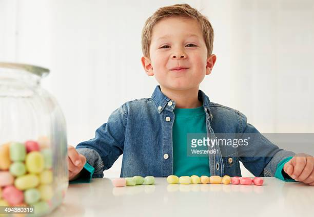Germany, Munich, Boy with candy jar