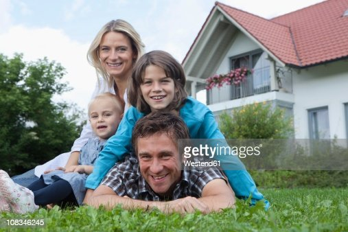 germany munich family in front of house smiling portrait stock photo getty images. Black Bedroom Furniture Sets. Home Design Ideas