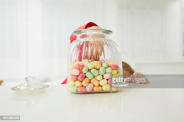 Germany, Munich, Girl with candy jar