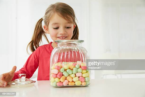 Germany, Munich, Girl with candy jar