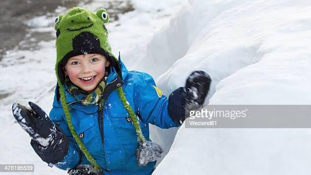 Germany, Munich, Little boy standing by igloo