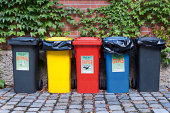 Germany, Munich, Various garbage containers in yard