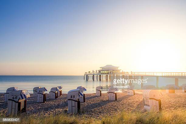 Germany, Niendorf, view to Timmendorfer Strand with hooded beach chairs and sea bridge