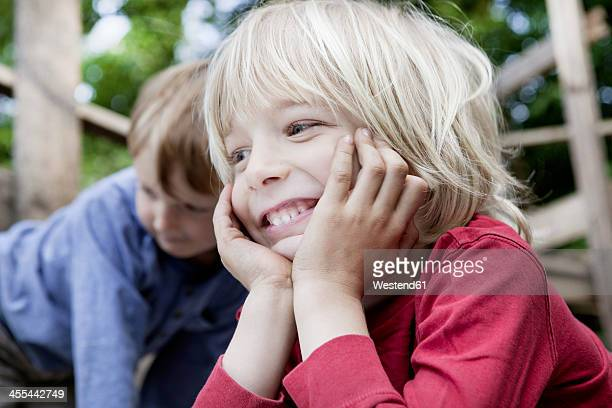 Germany, North Rhine Westphalia, Cologne, Boys in playground, smiling