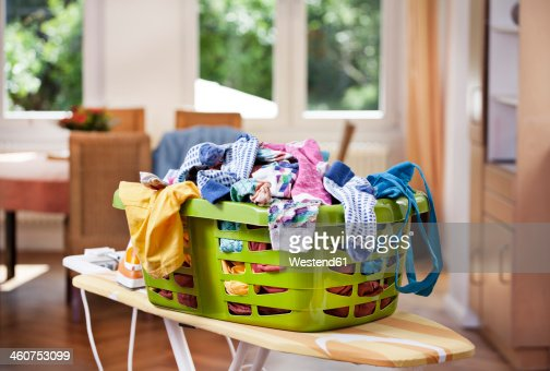 Germany, North Rhine Westphalia, Cologne, Clothes in laundry basket