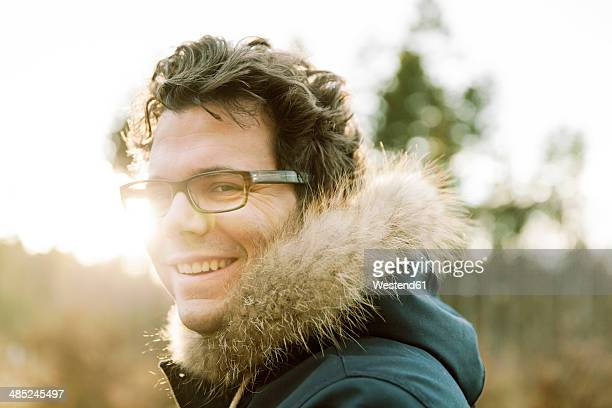 Germany, North Rhine-Westphalia, Bonn, man during winter walk in Waldua on Venusberg