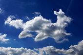 Germany, North Rhine-Westphalia, Cloud formation in form of a dog