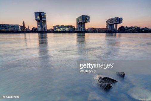 Germany, North Rhine-Westphalia, Cologe, view to crane houses at evening twilight