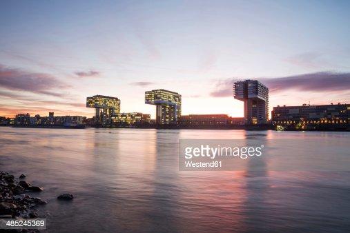 Germany, North Rhine-Westphalia, Cologne, Crane houses at Rheinau harbour by twilight