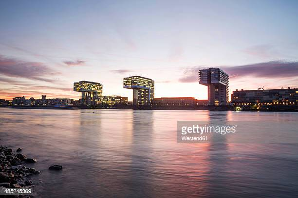 Germany, North Rhine-Westphalia, Cologne, Crane houses at Rheinau harbour by twilight
