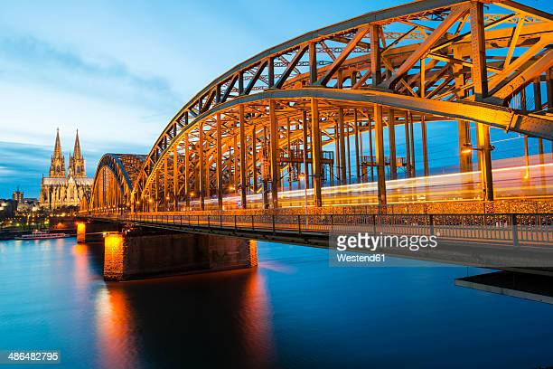 Germany, North Rhine-Westphalia, Cologne, view to Cologne Cathedral and Hohenzollern Bridge at evening twilight
