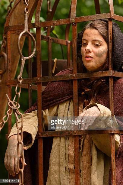 DEU Germany NRW Dortmund The Spectaculum from medieval times A young woman plays the role of a woman being in the pillory