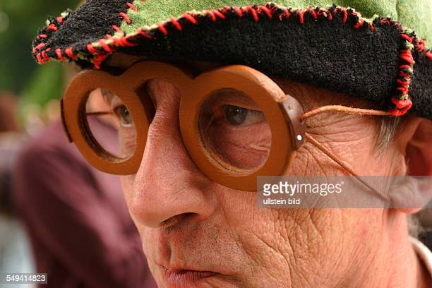 DEU Germany NRW Dortmund The Spectaculum from medieval times Amatuer actors play medieval everyday life This man wears glasses rebuilt from...