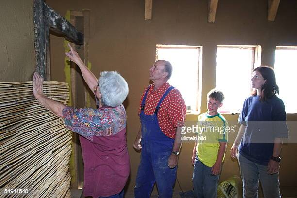 A halftimbered house gets completely new renovated Fixing reeds mats onto walls The reeds mats serve as carrier material for the wall plastering