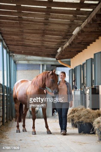 Germany, NRW, Korchenbroich, Young woman with her horse