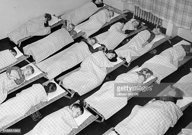 Germany NS Public Welfare preschool midday nap in a children's day care center Photographer PresseIllustrationen Heinrich Hoffmann Published by...