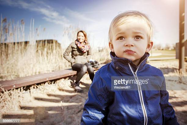 Germany, Oberhausen, toddler with mother on playground