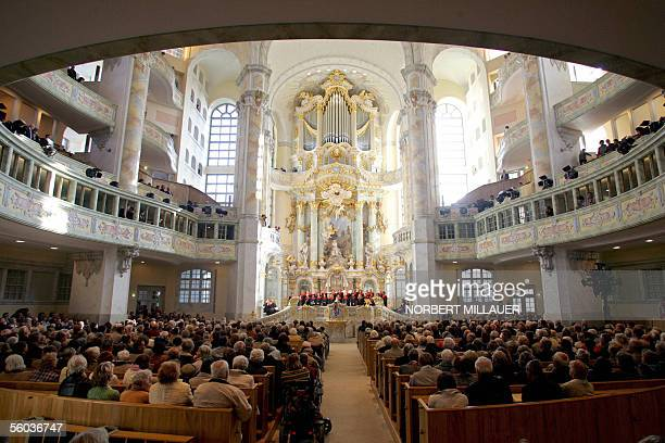 People attend on 31 October 2005 the reformation service at the rebuilt Frauenkirche in Dresden eastern Germany The spectacular baroque Protestant...