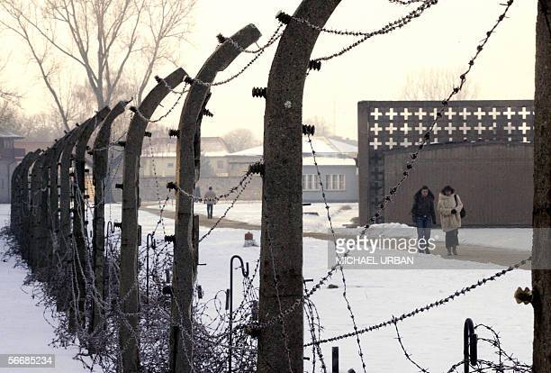 People walk in the Sachsenhausen concentration camp in Oranienburg just north of Berlin 27 January 2006 on the first international day of...