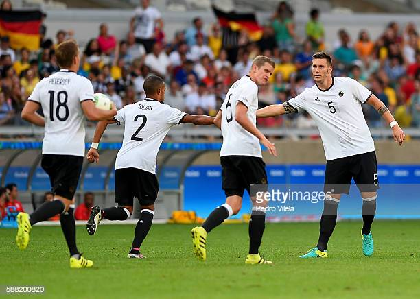 Germany players celebrate after scoring during the Men's First Round Football Group C match between Germany and Fiji at Mineirao Stadium on August 10...