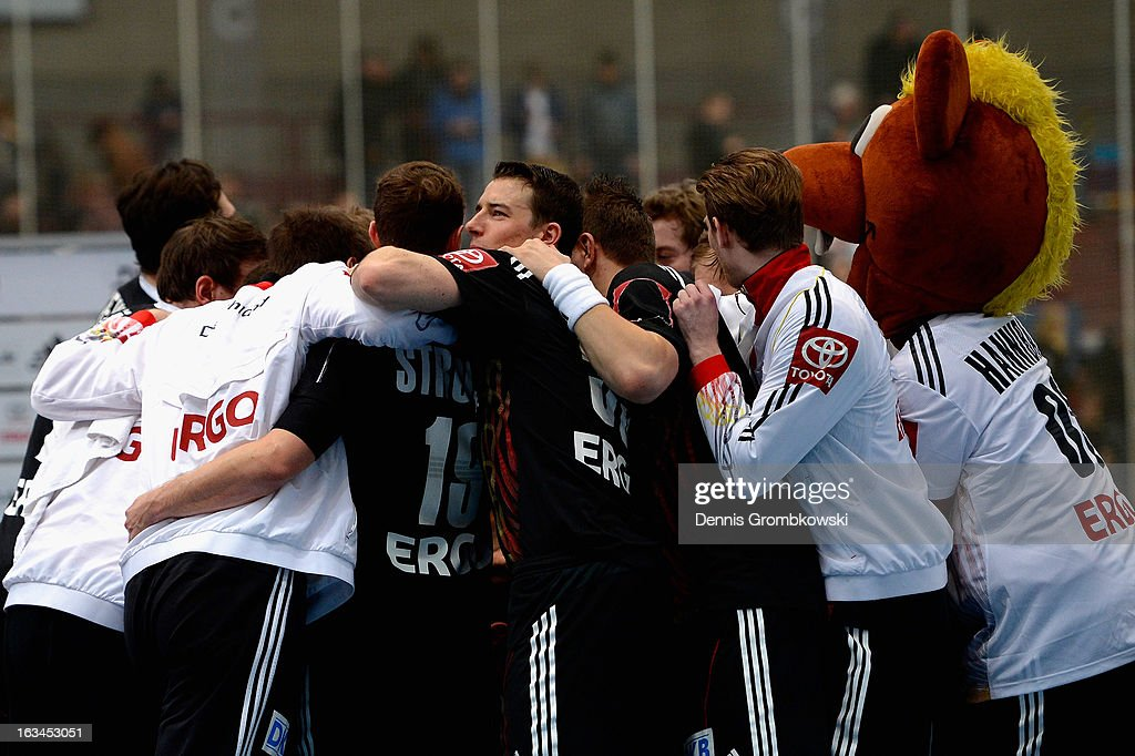 Germany players celebrate after the DHB International Friendly match between Germany and Switzerland at Conlog-Arena on March 10, 2013 in Koblenz am Rhein, Germany.