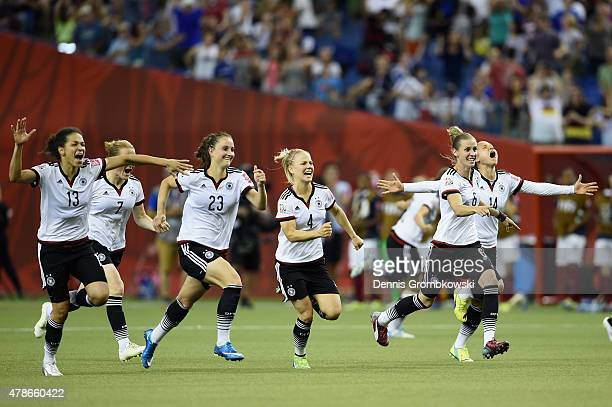 Germany players celebrate after the FIFA Women's World Cup Canada 2015 Quarter Final match between Germany and France at Olympic Stadium on June 26...