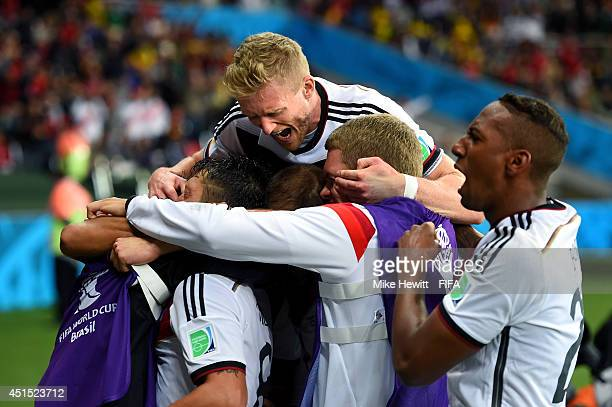 Germany players celebrate their second goal by Mesut Oezil during the 2014 FIFA World Cup Brazil Round of 16 match between Germany and Algeria at...