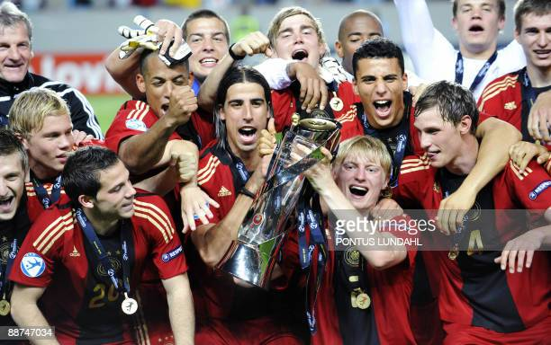 Germany players celebrate with the trophy their victory over England in the Under 21 European Championship final at the Malmo New Stadium on June 29...
