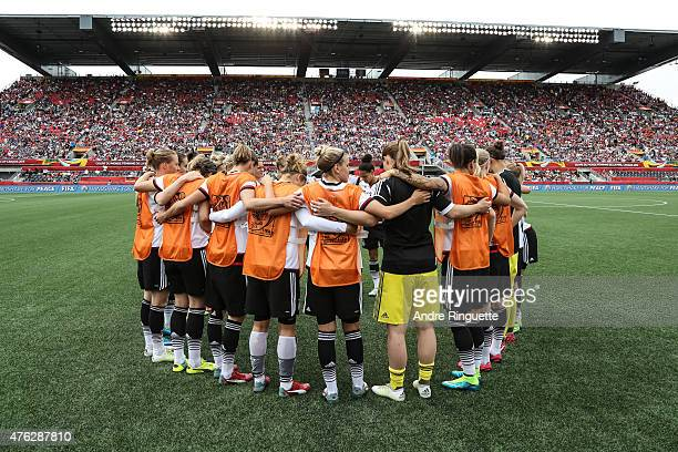 Germany players huddle together prior to kickoff during of Cote d'Ivoire during the FIFA Women's World Cup Canada 2015 Group B match between Germany...