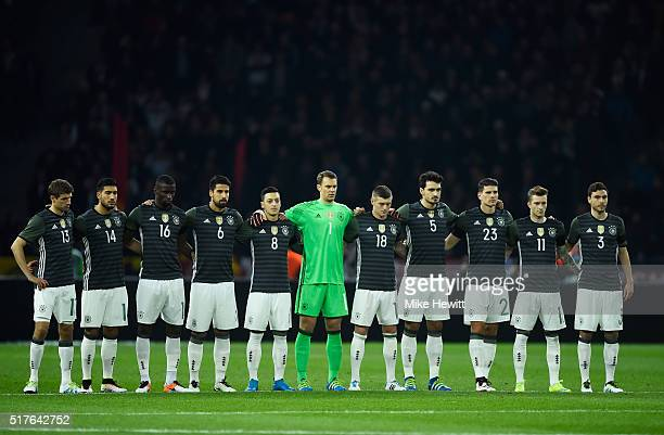 Germany players observe a minute of silence for the victims of Brussels terror attacks prior to the International Friendly match between Germany and...