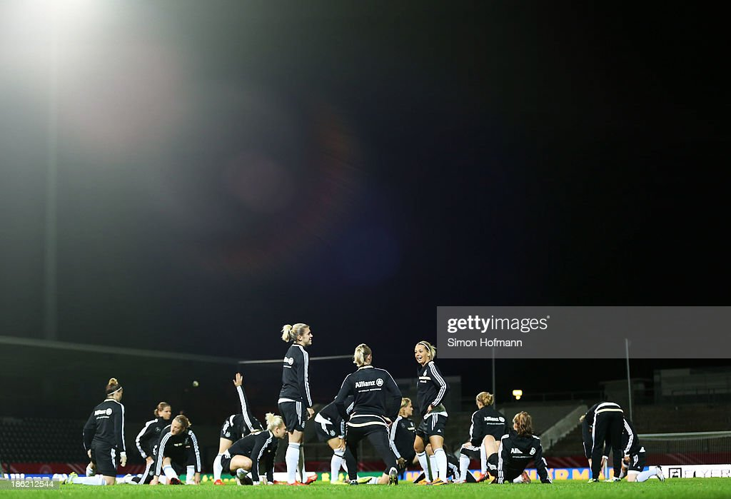 Germany players warm up during a Germany training session at Volksbank Stadion on October 29, 2013 in Frankfurt am Main, Germany.