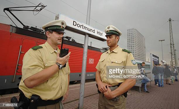 Policemen patrol the central railway station of Dortmund western Germany 22 August 2006 After the failed plot to bomb passenger trains turned out to...