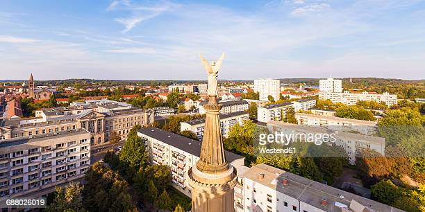 Germany, Potsdam, city view with angel figurine of St. Nicholas church in the foreground