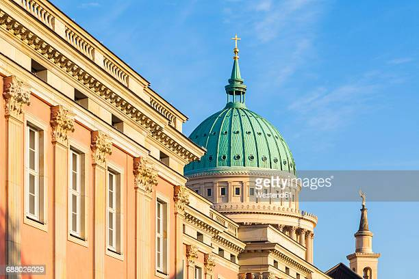 Germany, Potsdam, statehouse formerly city palace with St. Nicholas church in the background