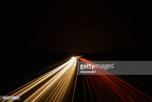 Germany, red and white lighttrails on freeway by night, long exposure
